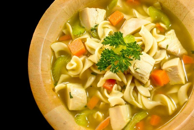hot-bowl-of-chicken-noodle-soup-on-a-dark-background
