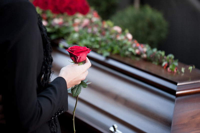 woman-at-funeral-with-coffin