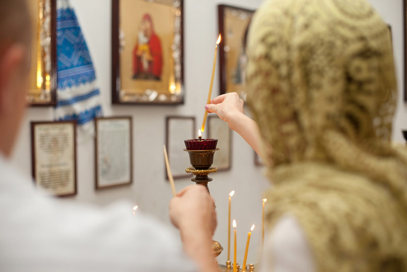 female-and-candle-in-church