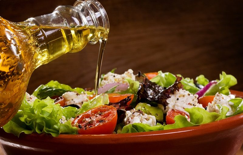 vegetable-salad-with-olive-oil-pouring-from-a-bottle